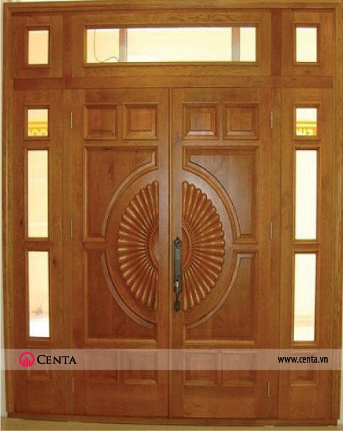 Mẫu cửa 1: Mẫu cửa 4 cánh gồm 2 cánh giữa lớn, 2 cánh nhỏ có kính. Trang trí hoa văn tròn phần cánh chính.