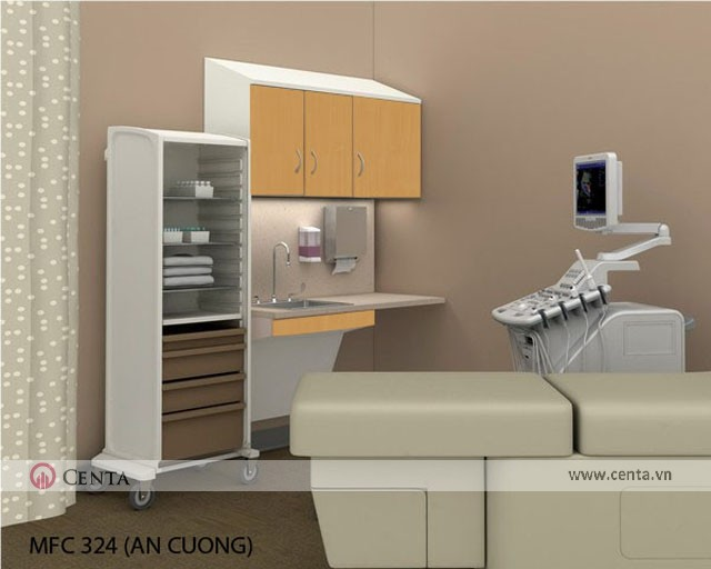 Phòng khám bệnh có máy móc đo khám, tủ đựng đồ vật tư y tế và lavabo rửa tay cho bác sỹ