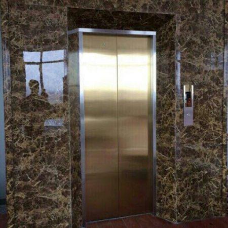 Ốp mặt thang máy bằng đá marble Dark Emperador