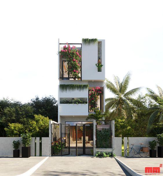 Thiết kế nhà đẹp sử dụng hình khối chữ nhật và ô thông gió chữ nhật dài. Đan xen trồng cây thân mềm và hoa giấy tại mặt tiền. Tầng 1 có hàng rào sắt đơn giản