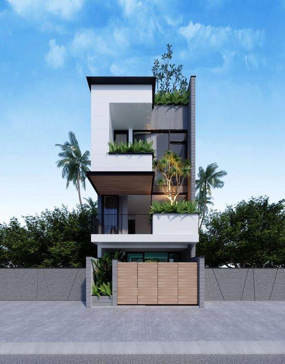 Mẫu nhà đẹp khi không dùng kiểu thiết kế đơn điệu cho nhà phố. Các khối mặt tiền được thiết kế nổi chìm đan xen phá cách. Tương phản 3 màu sắc trắng ghi nâu rõ ràng