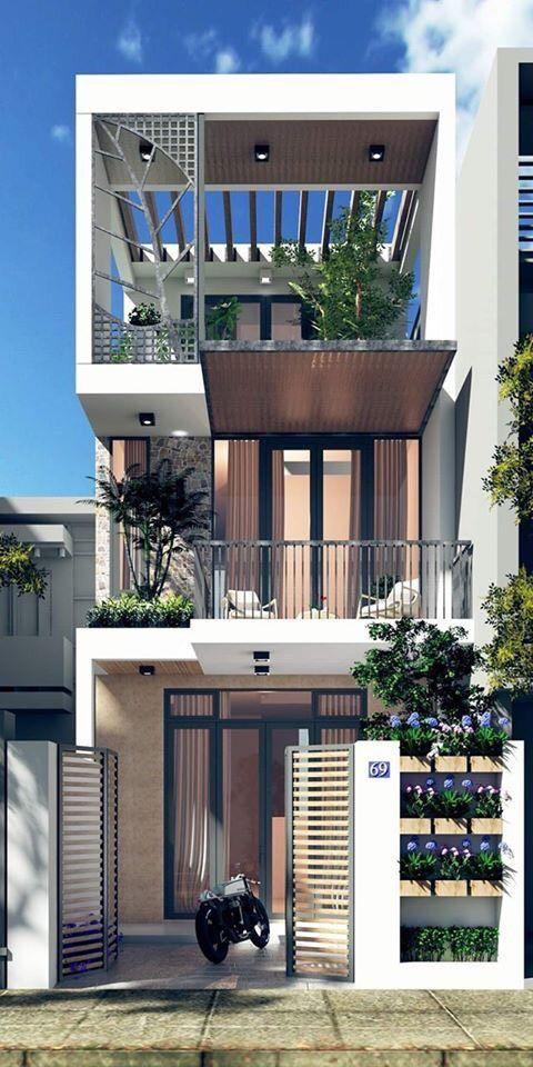 Mẫu nhà phố 3 tầng hiện đại điển hình cho xu hướng thiết kế kiến trúc phù hợp khí hậu nhiệt đới nóng ẩm mưa nhiều của Việt Nam