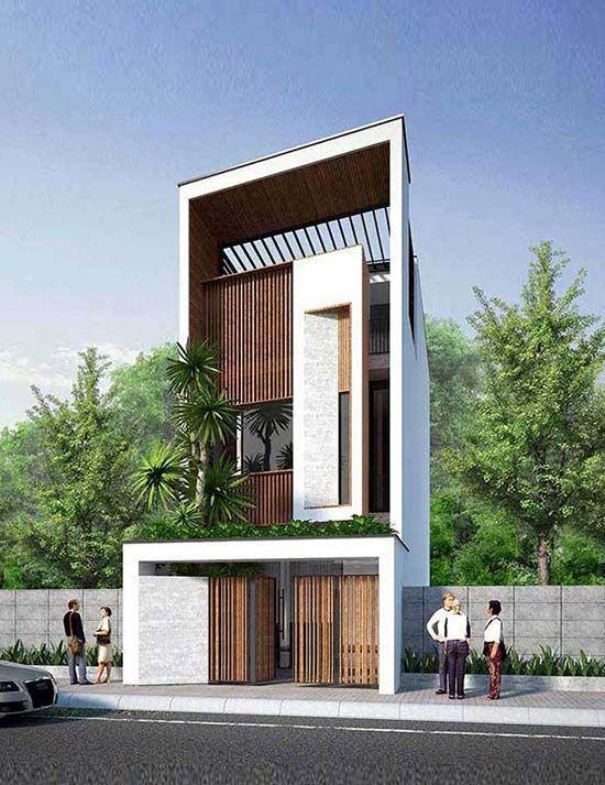 Mặt tiền mẫu nhà phố độc đáo được phân tách thành 2 khối lệch trục. Tầng 1 trang trí bằng ốp lát chéo tường khu cửa tạo ấn tượng lạ cho khách. Tương phản khối chữ nhật màu trắng với hệ lam sắt giả gỗ