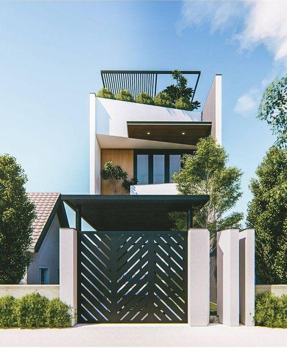 Mẫu nhà phố 2 tầng 1 tum có trồng cây xanh trên mái, cổng sắt