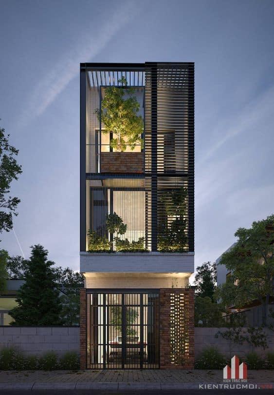 Mẫu nhà phố 3 tầng có lam chắn nắng và cây xanh