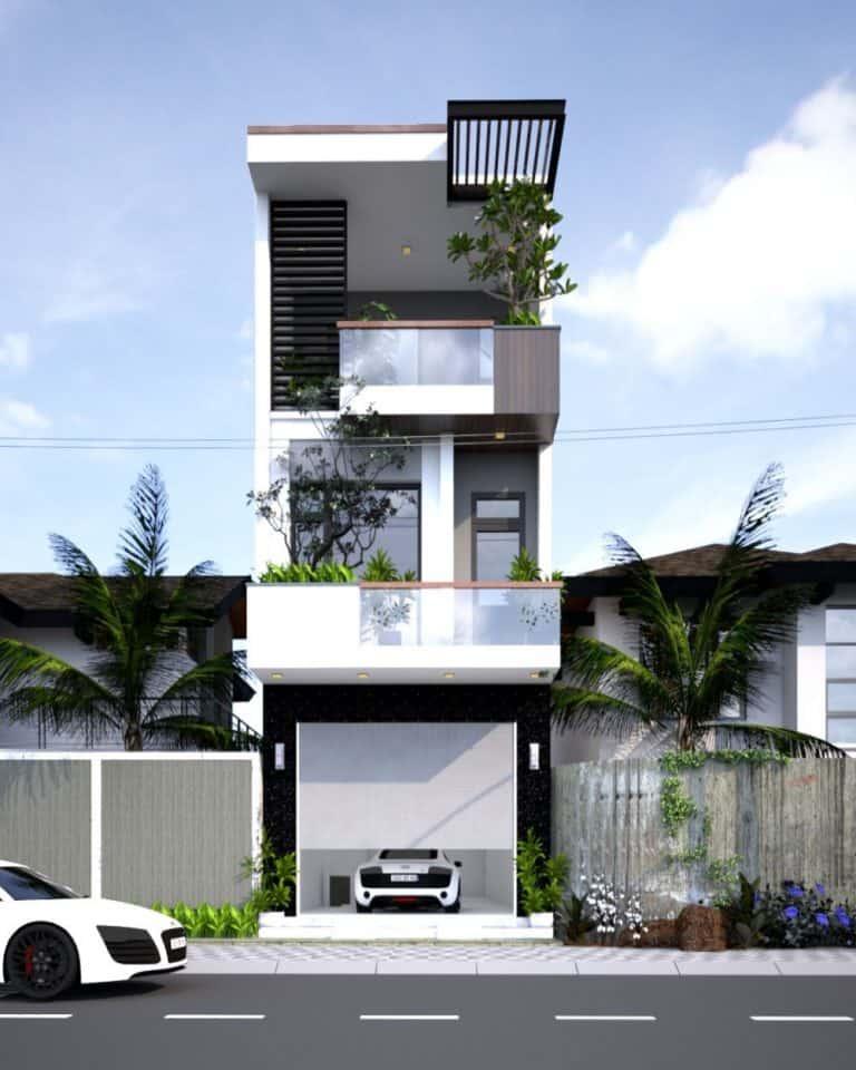 Mẫu nhà phố đẹp 3 tầng có ban công kính cây xanh và lam chắn nằng, gara ô tô