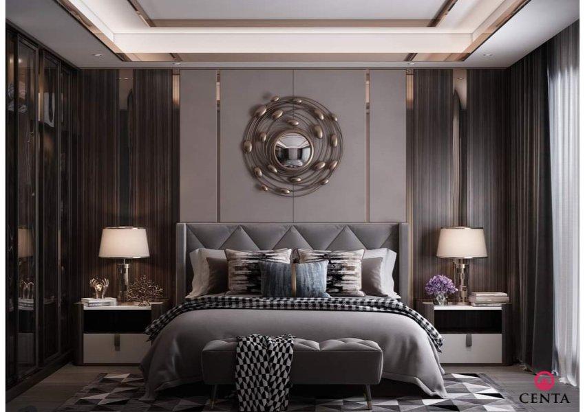 Phòng ngủ vợ chồng có gam màu sẫm với đèn trang trí, gương trang trí treo tường, tủ áo cánh kính