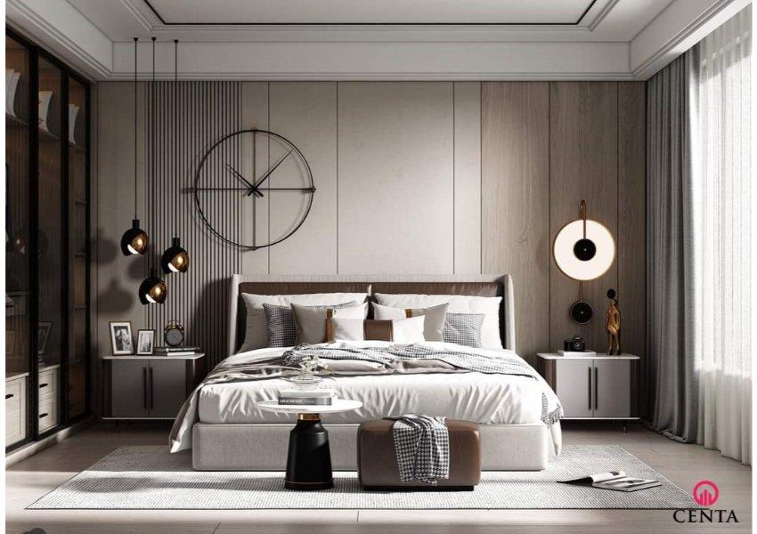 Mẫu phòng ngủ có kiểu giường bọc nỉ bo ôm kết hợp màu da nâu và trắng, thạch cao giật cấp hiện đại